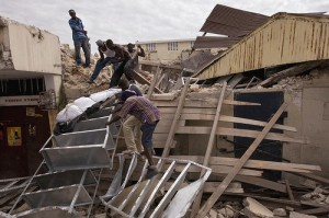 Haitians Retrieve Deceased from Collapsed Building